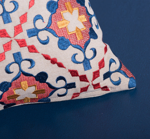 Embroidered pattern pillow in red and blue by Déniché Boutique