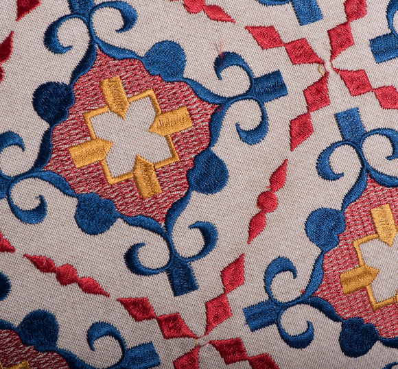 Cream, blue and red embroidered decor pillow by Déniché Boutique