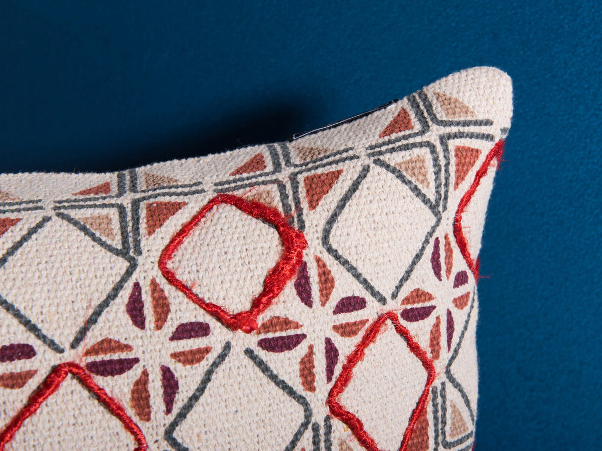 Cream, red, and blue bohemian cushion by Déniché Boutique