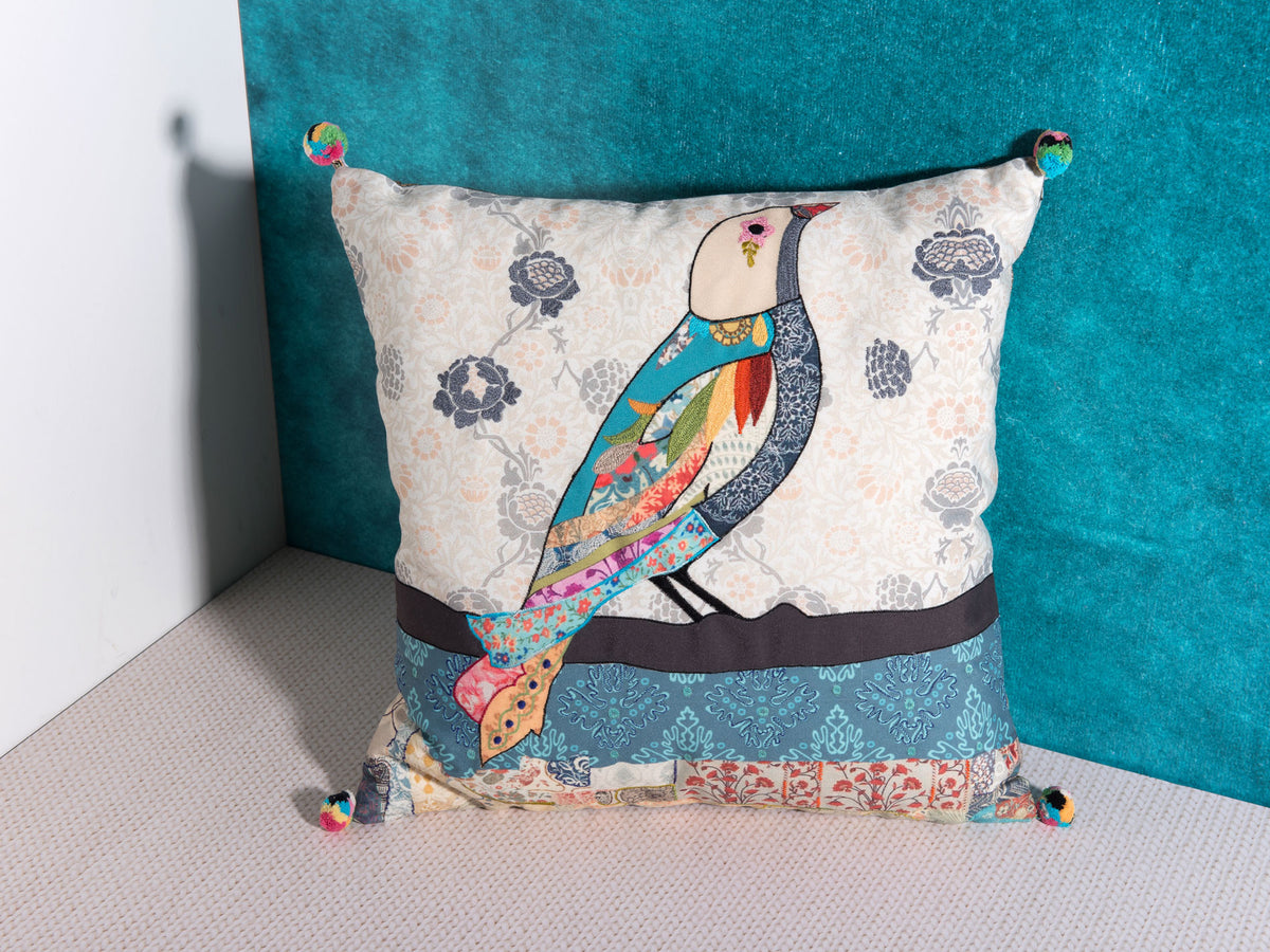 Sol bird embroidered pillow by Déniché Boutique