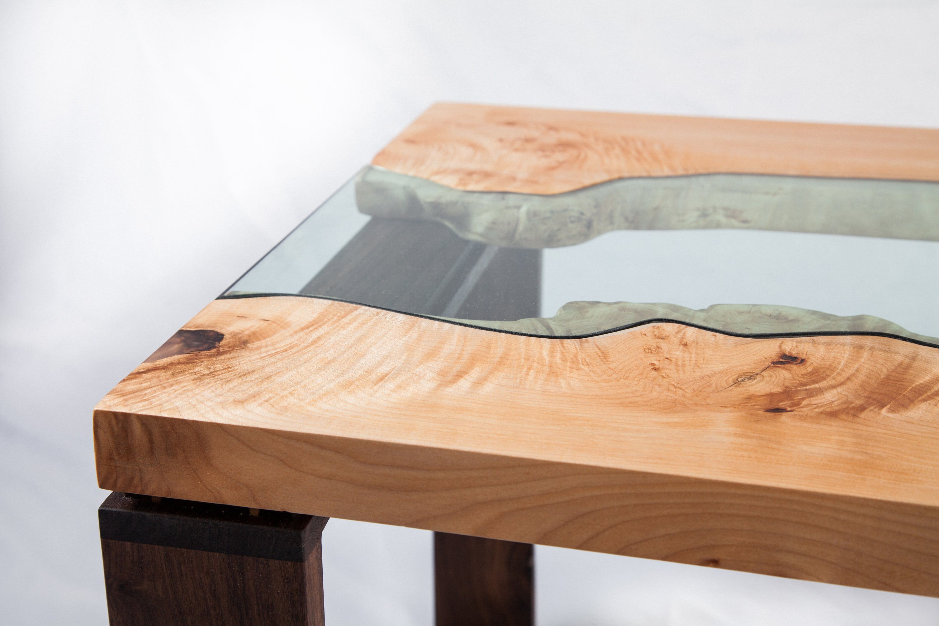 Handmade river coffee table with a big leaf maple top, river glass centre, and square walnut legs