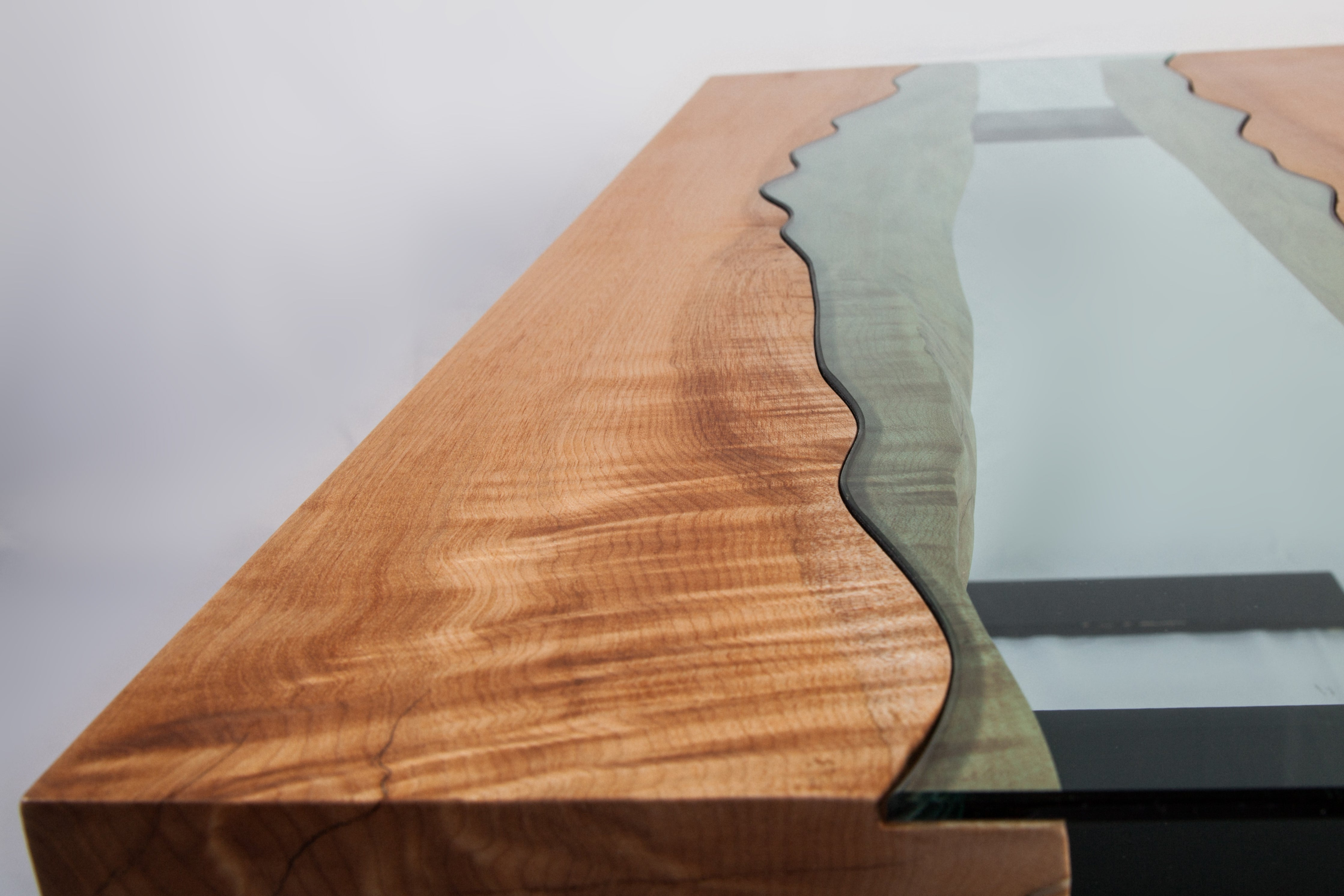 Handmade river coffee table with a big leaf maple top, river glass centre, and black powder coated steel legs