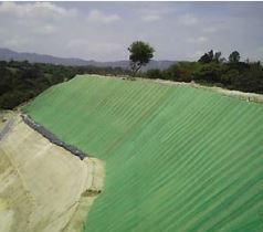 Green turf reinforcement mats installed on steep slope