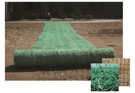 Green colored Erosion Control Blanket being rolled out on the side of road