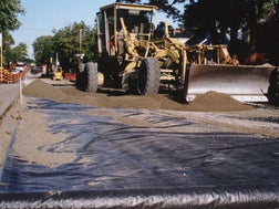 Geotex woven fabric being installed on road