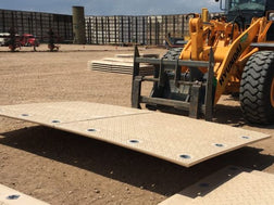 MegaDeck Mat being moved on job site