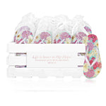 20 pairs of pastel flower flip flops in a personalized crate