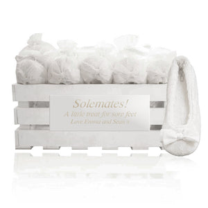 20 pairs of slippers in a personalized crate