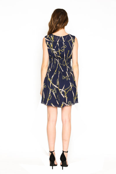 Lenon Collection. Viscose Georgette Navy Chain Print Back smocking Plunging neckline Side hidden zipper.