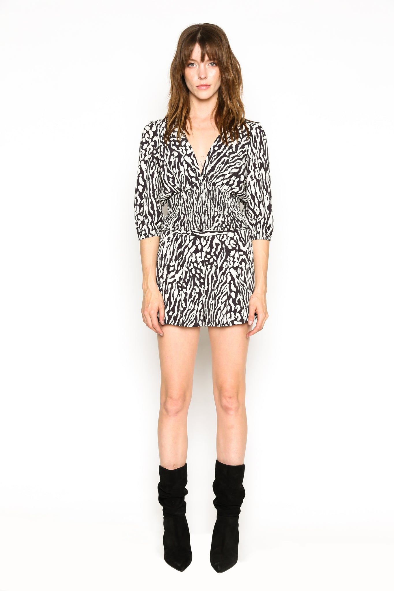 Lenon Collection.Baby Twill Blk/White Animal Print Smocking hem V neckline