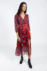 Lenon Collection. Midi dress with side slit in a satin/chiffon combination. Wine red ditsy floral print. Mini ruffle shoulder detail.
