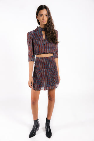 Lenon Collection. Light crepe mini skirt in red/blue checkered print. Back zipper detail.