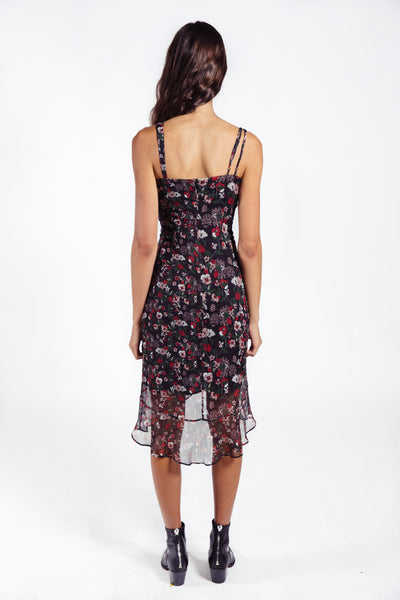 Lenon Collection. Crinkle chiffon in black/red multi floral print. Adjustable straps and a subtle high-low hemline. Ruching detail  running down on the side. Sheer hemline.