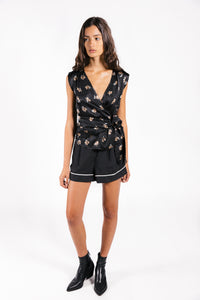 Lenon Collection. Black satin tulip print wrap blouse. Mix media fabrication with side zipper.