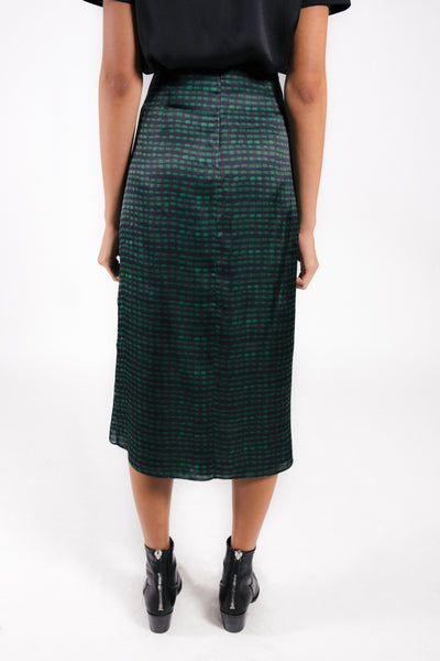 Satin skirt  featuring a green checkered print with center gathering. Back zipper.