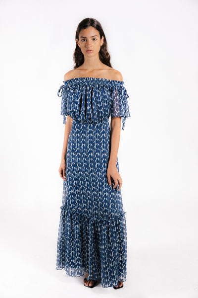 Lenon Collection. Off the shoulder maxi dress. Bow tie detail on shoulder. Blue and Black print in crinkle chiffon.