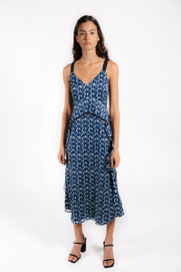 Lenon Collection. Cascading ruffle midi dress.  Blue printed striped jacquard with adjustable straps.