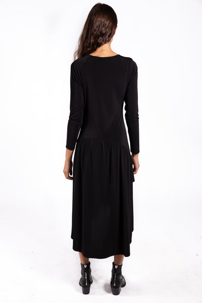 Lenon Collection. Black long sleeve midi dress with asymmetrical  neckline. Cinch detailing down to the waist in matte jersey.