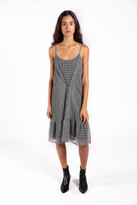 Lenon Collection. Crinkle chiffon in a black/white geometric print. Billowy silhouette with center button and adjustable straps.