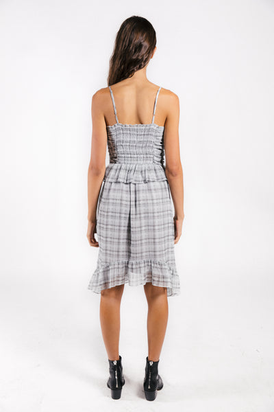Lenon Collection. Smocking detail over the bust with ruffle waist line and adjustable straps. Featured in a grey plaid crinkle chiffon.
