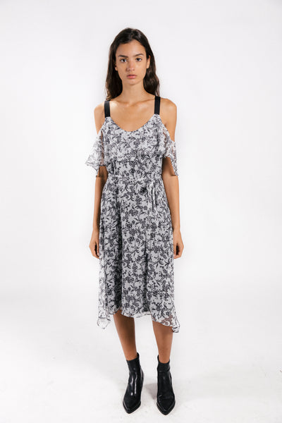 Lenon Collection. Cold shoulder midi dress with self belt. White/ Black floral print in crinkle chiffon.