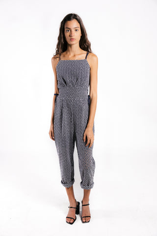 Lenon Collection. Blue embroidered eyelet jumpsuit with side tie detailing. Adjustable double straps.