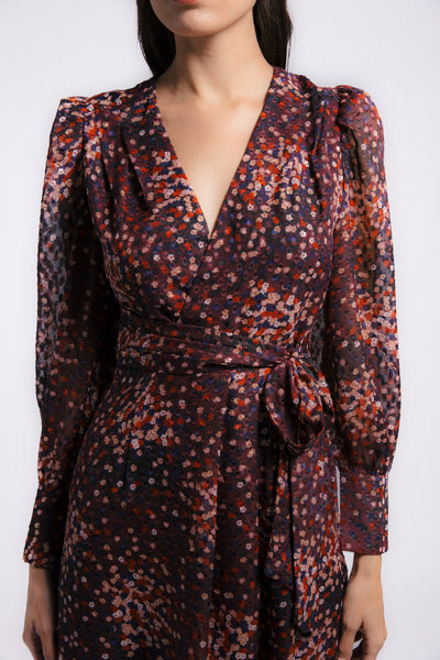 Leon Collection. Wrap tie mini dress. Chiffon dot jacquard in burgundy ditsy floral print. Button sleeve detail.