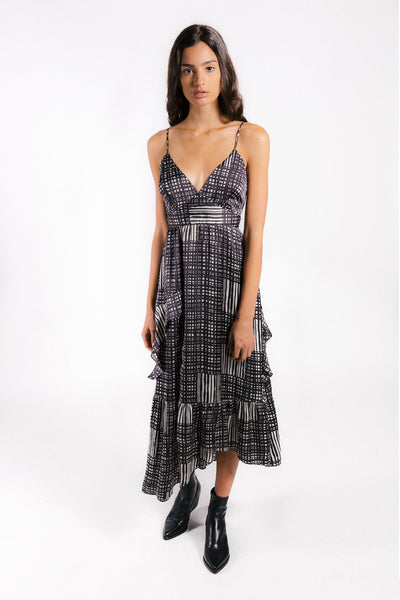 Lenon Collection, Amelia Dress in Black and White Plaid Print. Adjustable Straps with Asymmetrical hemline  and Front Ruffle Detail in a Matte Satin fabrication.