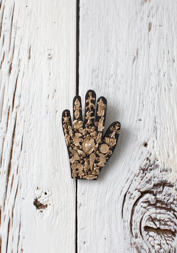 Carved Wooden Hand With Milagros