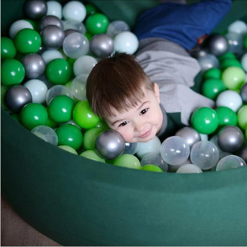 Big green ball pit with balls