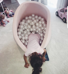 Small pink ball pit with balls
