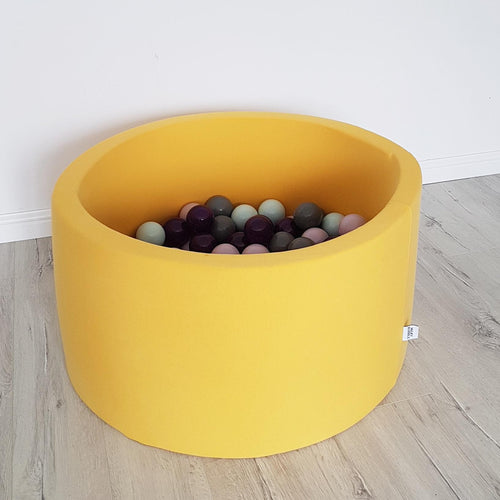 Small indoor yellow ball pit with balls