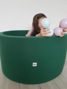 Small indoor green ball pit with balls