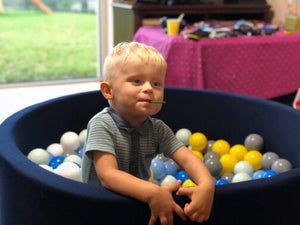 Small navy blue ball pit with balls