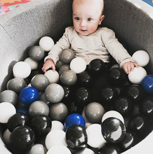 Small dark grey ball pit with balls
