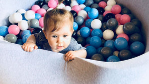 Big light grey ball pit with balls