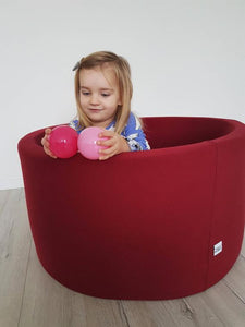 Small burgundy ball pit with balls