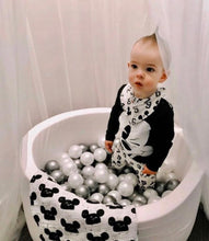Small white toddler ball pit with balls