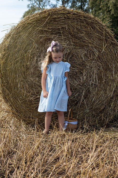 Light blue cotton girl dress with ruffles