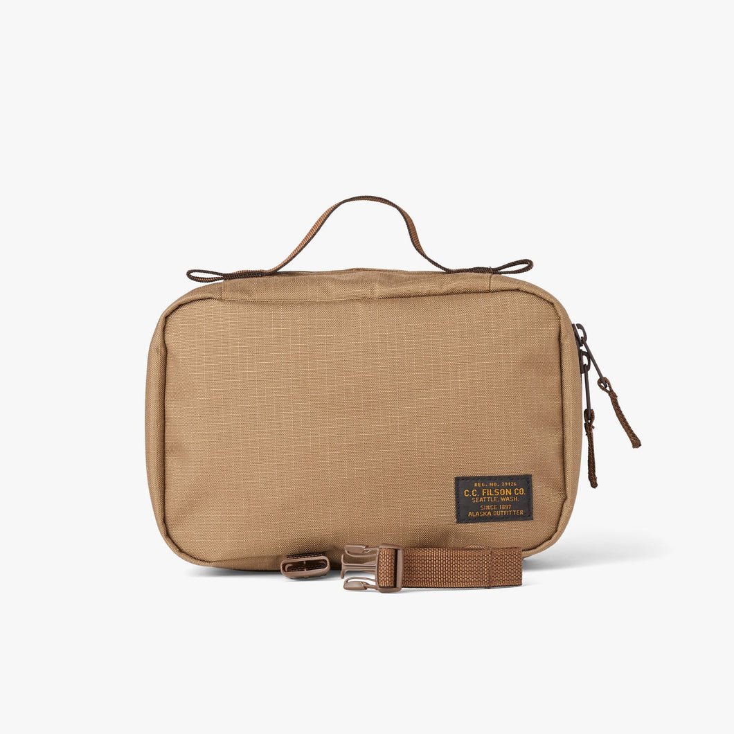 Filson six whiskey front view Ripstop Nylon travel pack in tan