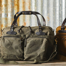Load image into Gallery viewer, Filson duffle bag at 6 whiskey otter green tin cloth