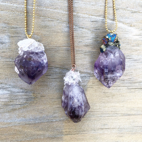 Three amethyst necklaces with crowned quartz and chalcopyrite