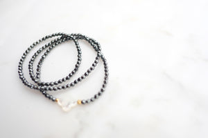 Hematite Triple Wrap with Mother of Pearl Clover