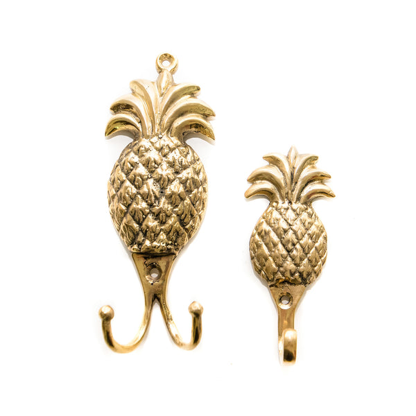 Everyone knows the pineapple is the symbol of everything tropical and when we see the pineapple your mind imagines, palm trees, beaches, hot balmy nights sipping cocktails.  Everything nice.  So not only our our brass pineapple hooks a great decor piece they are just plain practical.  Because they are made of solid bronze not flimsy tin they can be used indoors or outdoors. I have them available in small or large