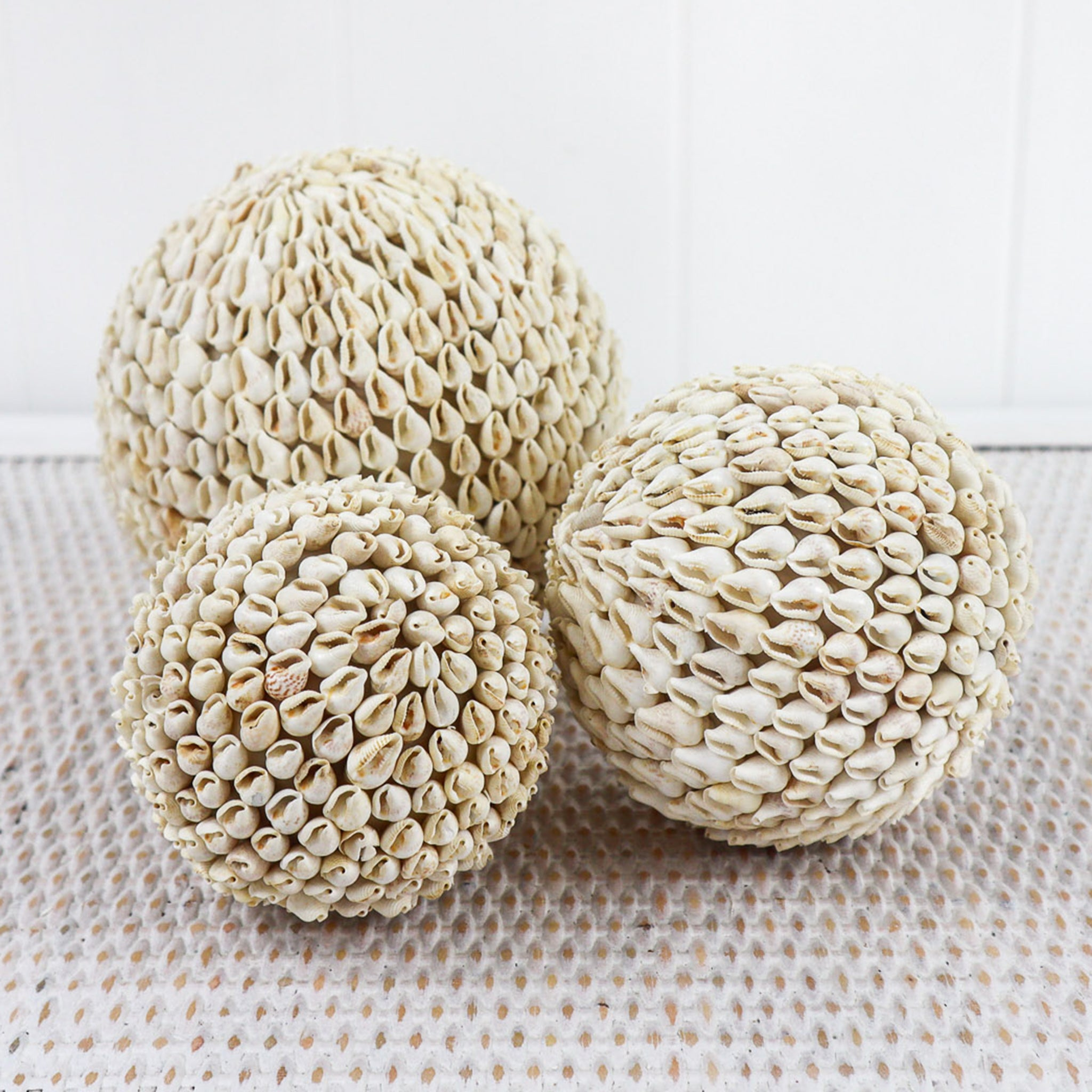 There is so much painstaking work that has gone into making these shell balls. Hundreds of tiny shells making up one big ball.   They always look so elegant when several are placed in a beautiful glass vase or in a rustic rattan bowl.  These also make interesting gifts.