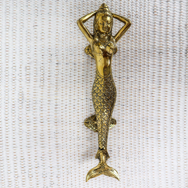 These mermaids are so popular I only have one left. They have the magical ability to turn an ordinary front door into the entry of a tropical retreat. They are so strong, heavy and beautifully handcrafted from bronze.