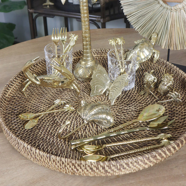 You can see lots of bronze from the collection here. Sea Grass Table Art, brass candlesticks, brass crab, brass butterfly, brass turtle, brass napkin holders, brass servers, brass wall hooks all on a beautiful round rattan tray.