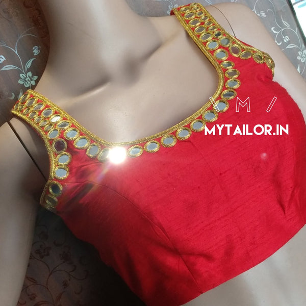 Gorgeous party wear sleeveless blouse with mirror work