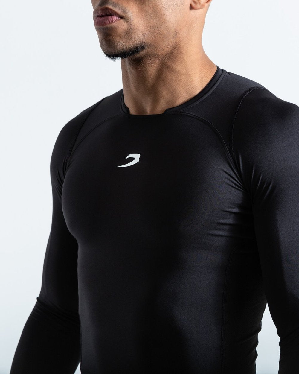 SADDLER COMPRESSION TOP - Pandemic Fight Gear Inc.