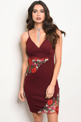 Ladies fashion sleeveless fitted bodycon dress with a v neckline and floral details